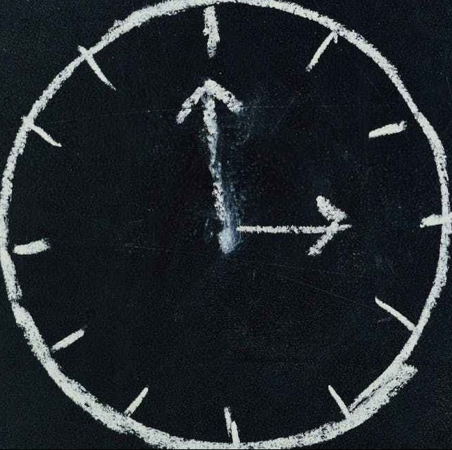 analog clock sketch in black surface